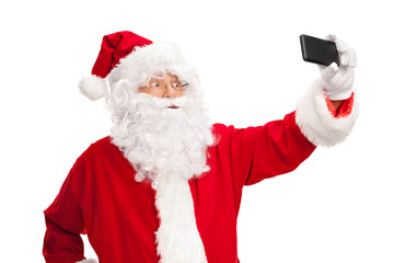 Studio shot of Santa Claus taking a selfie
