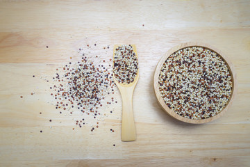 Tri-color Quinoa Super food on wood dish and wood spoon Top view
