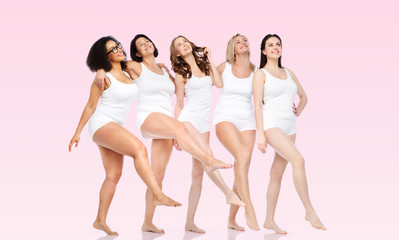group of happy different women in white underwear