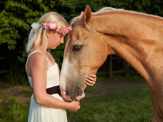 Girl hugs her horse