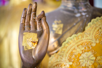 goldleaf in hand of buddha statue