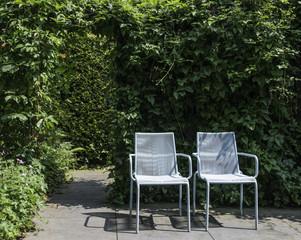two blue seats in garden