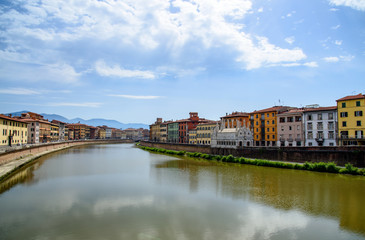 old architecture and river Arno, Pisa, italy