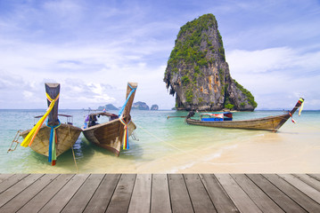 long boat and white sand beach on island in Thailand