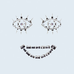 Funny image of smiley face, assembled from retro cameras on a gray-blue background