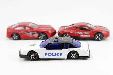 Two sport cars and police