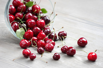 Healthy cherry in bowl on wooden table. Selective focus, high resolution product. Harvest Concept