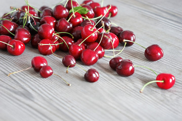 Cherry on old wooden table in daylight. Close up, high resolution product. Harvest Concept
