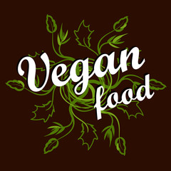 """the emblem with the inscription: """"Vegan food"""" in brown and green colors."""