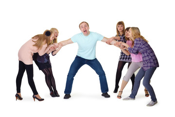 Girls pull man's hands