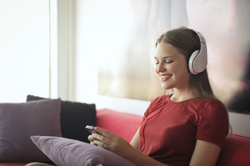 Smiling girl listening to music and chatting