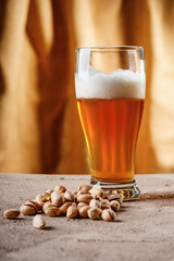 Glass of beer and pistachio nuts