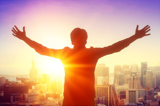 Man silhouette celebrating success