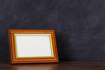 Picture frame against a dirty blackboard background