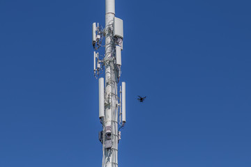 Drone inspecting right side of a cell tower