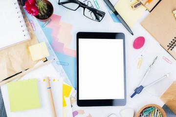 Blank tablet on office desktop