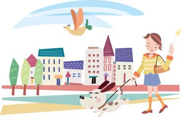 若い女性が街を犬とお散歩