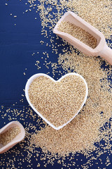 White grain quinoa on blue wood background.