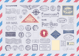 collection of mail themed design elements -grungy textured postage and rubber stamps, postcard headers and blank backgrounds/frames  on an airmail envelope background