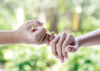 Little finger cross each other concept of promise