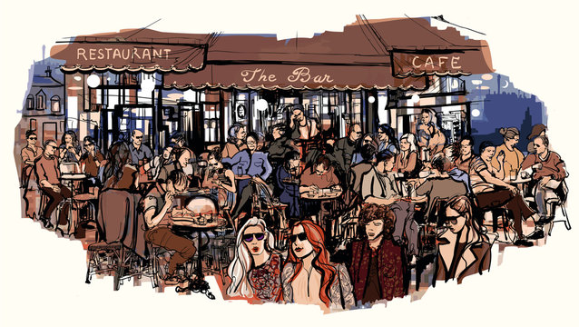 Customers at traditional outdoor Parisian cafe