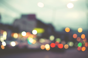 Artistic style - Defocused urban abstract blurred bokeh lights. City blurring light in the background for your design, vintage or retro color tone style.