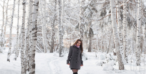 Beautiful young girl in winter forest