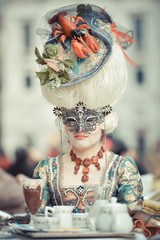 Venetian masked model from the Venice Carnival in Italy