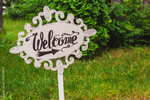 Handmade Wooden Board With Welcome Sign In The Garden Wedding