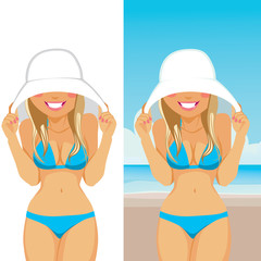 Beautiful young shy blonde woman in bikini hiding her face with big white hat on the beach