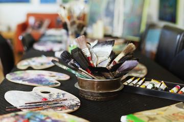 Painting tools on table at art studio