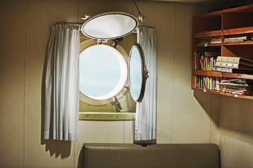 Porthole in the cabin of an old yacht