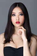 Studio fashion shot of Asian woman