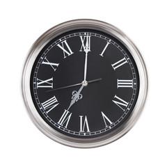 Clock shows exactly seven o'clock
