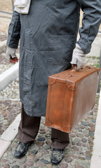 immigrated with old leather suitcase