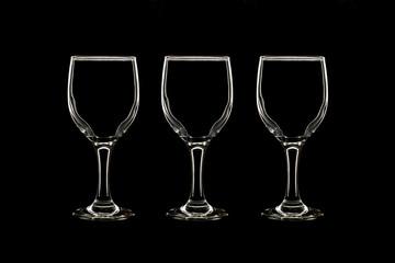 Empty three wine glass on black background