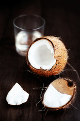 Fresh Coconut over dark wooden background. Close up of coco nut