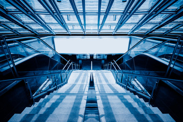 stairs in office building,blue toned image,spiritual concept.