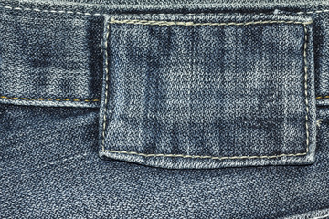 Denim jeans texture or denim jeans background with label of fashion jeans design with copy space for text or image.