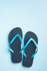 Blue flip flops.