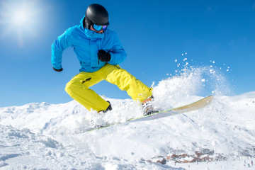 Active snowboarder in mountains
