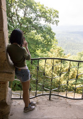 woman photographing valley view, Czech-Saxon Switzerland National Park