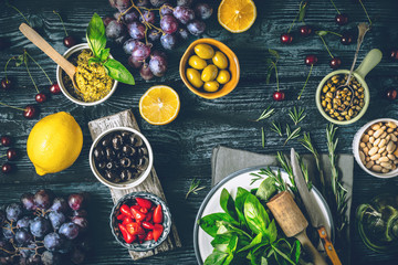 Concept of Mediterranean cuisine. Different fruit , herbs and appetizers on the wooden table top view