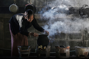 Women are cooking in rural Thailand