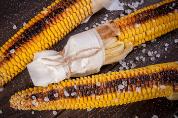 Organic Grilled Corn with sea salt on a wooden table