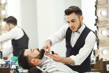 Barber making a beard