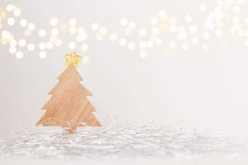 Wooden christmas tree with sparkly lights background