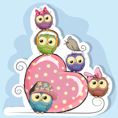 Five Owls is sitting on a heart