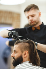 Barber doing haircuts for client
