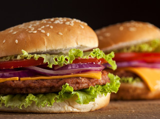 Fresh burgers on wooden background